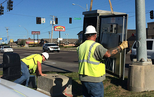 Mobility experts installing traffic cabinets